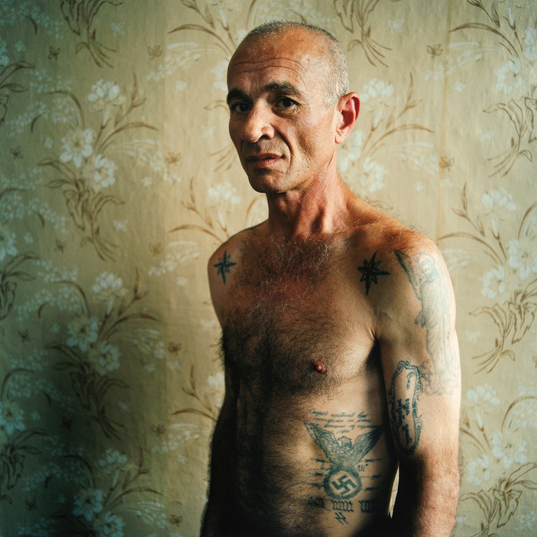 A man with Swastika Tattoo, Men's prison, Ukraine 2008 ( Wouldn't reveal his crime )