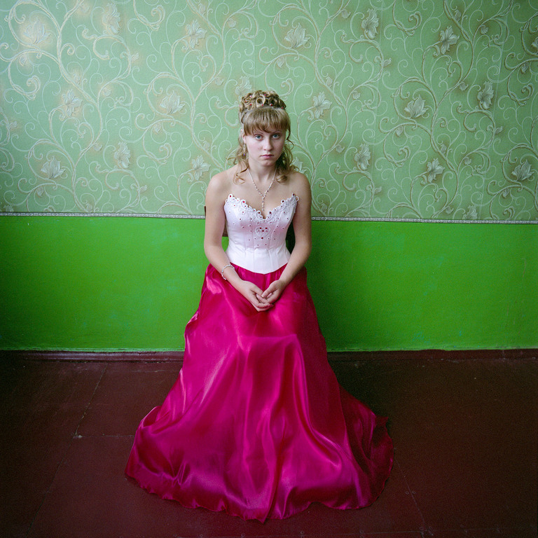 Girl in a boarding school for youth from broken homes,  dressed for graduation, Ukraine 2008