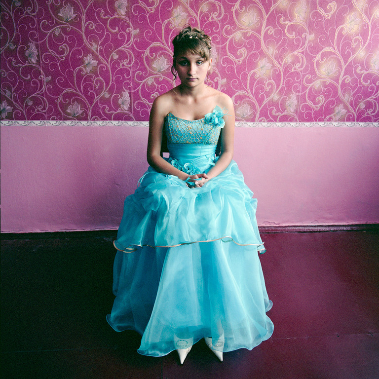 Girl in a boarding school for youth from broken homes, dressed for graduation_ Ukraine 2008